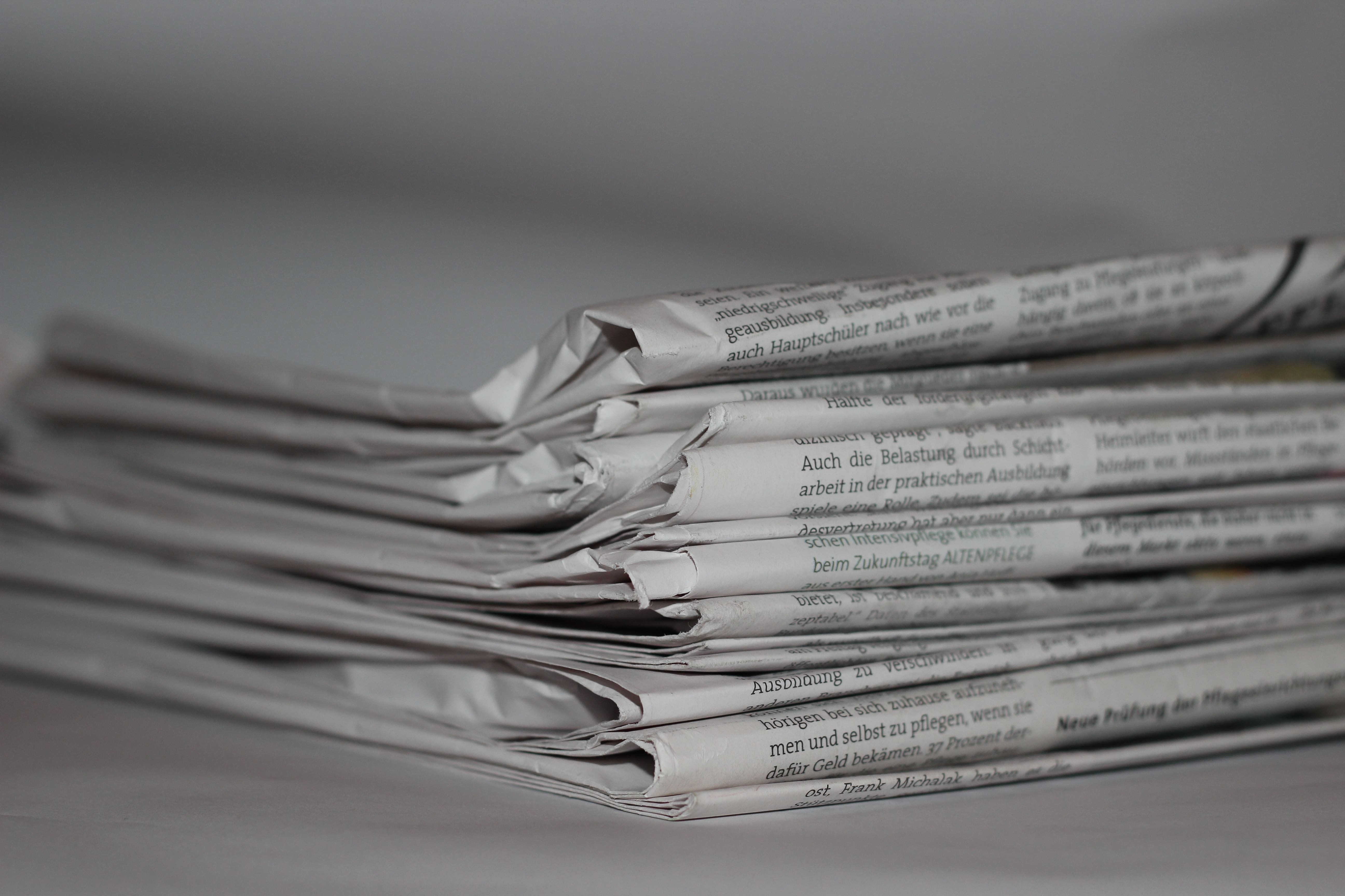 stacked newspapers crisis management
