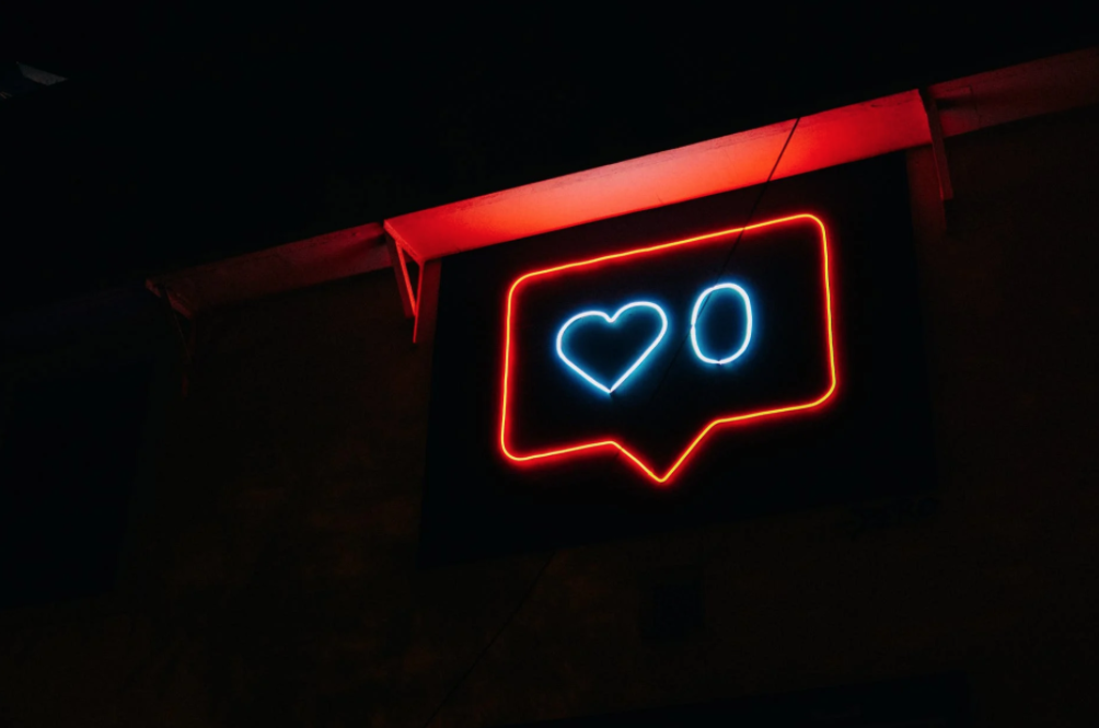 neon sign featuring motifs used in ublic relations and social media